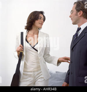 Couple dressed to leave - Stock Photo