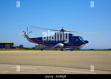 British International Helicopters Sikorsky S61 taking off from St.Mary's Heliport - Stock Photo