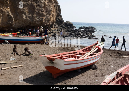 Kids and fishing boats on the beach in Cidade Velha - Cape Verde - Stock Photo