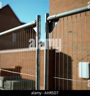 Metal fence near house - Stock Photo
