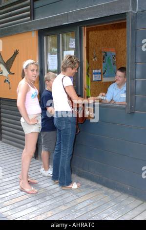 Visitors to the RSPB Osprey bird hide at Loch Garten - Stock Photo