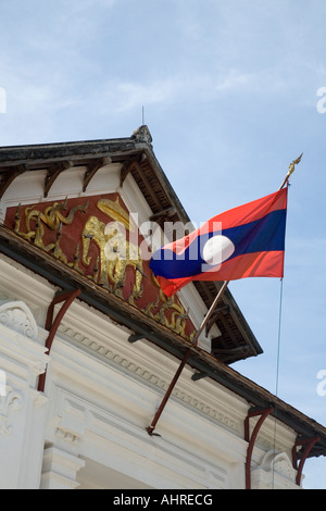 Lao flag at the entrance of the Royal Palace Museum in Luang Prabang Laos - Stock Photo