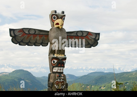 A First Nations totem pole sits atop the Malahat on the Trans Canada Highway near Victoria BC - Stock Photo