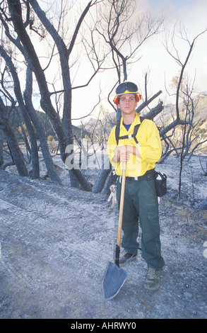 Forest fire fighter holding shovel Los Angeles Padres National Forest California - Stock Photo
