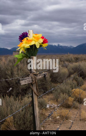 Cross and flowers marking an accidental death - Stock Photo
