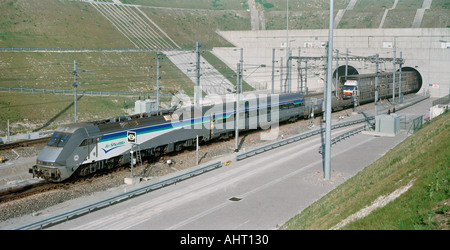 Eurotunnel heavy goods vehicle (HGV) shuttle train exits the French Portal at Calais after travelling through the - Stock Photo