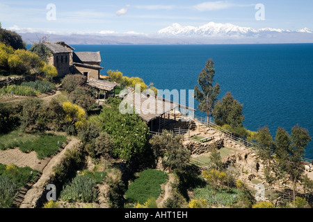 View over the lake to Cordillera Real and Mount Illampu - Stock Photo