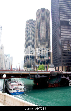Marina City apartments located on the Chicago River with tour boat in the foreground. Chicago Illinois IL USA - Stock Photo