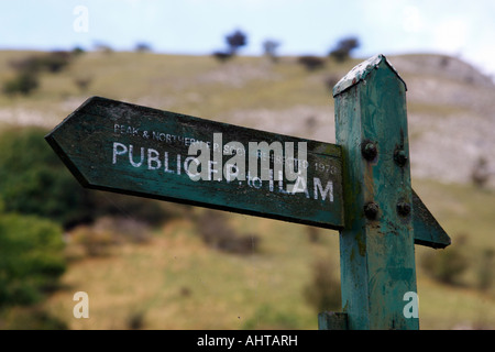 old wooden public footpath sign to ilam erected in 1973 at dovedale peak district national park derbyshire england - Stock Photo