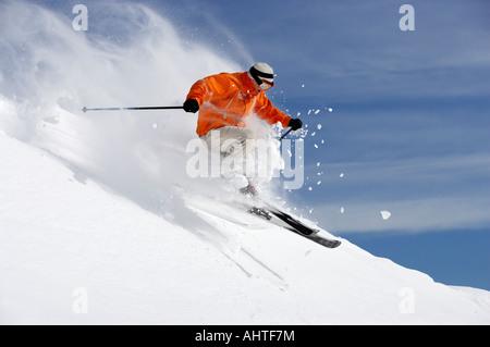 Austria, Saalbach, male skier jumping on slope - Stock Photo