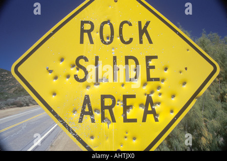 A sign that reads Rock Slide Area - Stock Photo