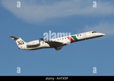 PGA Portugalia Embraer ERJ 145 regional airliner in flight on departure against a blue sky. Short haul air travel. - Stock Photo
