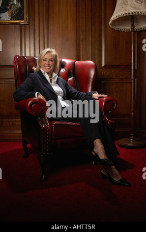 Businesswoman in a comfy leather chair - Stock Photo