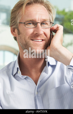 Close-Up portrait of Businessman using mobile phone. - Stock Photo