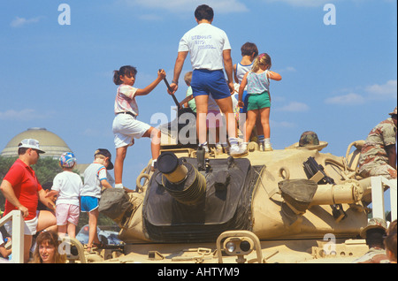 People Looking at Military Tank on Display Washington D C - Stock Photo