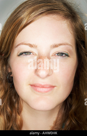 Young female looking at camera - Stock Photo
