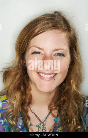 Young female smiling looking at camera - Stock Photo