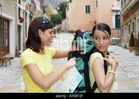 Two travelers in old city with map. - Stock Photo