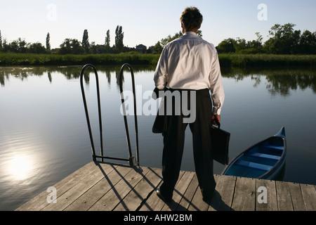Businessman standing on Pier. - Stock Photo