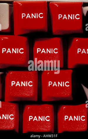 Red panic buttons on computer key board - Stock Photo