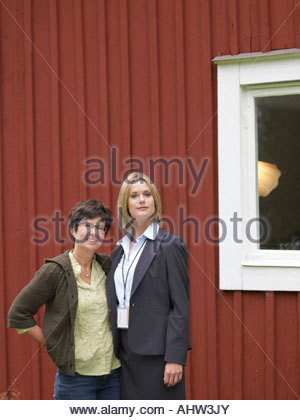 Mother and daughter outside country cottage - Stock Photo