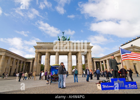 Horizontal wide angle of the Brandenburg Gate with lots of tourists at Pariser Platz on a bright sunny day. - Stock Photo