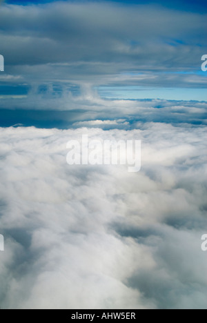 Horizontal aerial view of cloud layers and different formations in a blue sky from a high altitude - Stock Photo