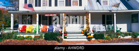 This is the Salt Ash Inn Bed and Breakfast It is a large white house with a large front porch There are brightly - Stock Photo