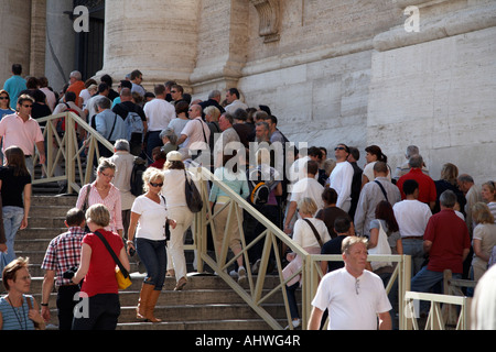 Tourists queuing outside the Basilica in St Peters Square to gain entrance to the cupola Vatican City Rome Lazio - Stock Photo