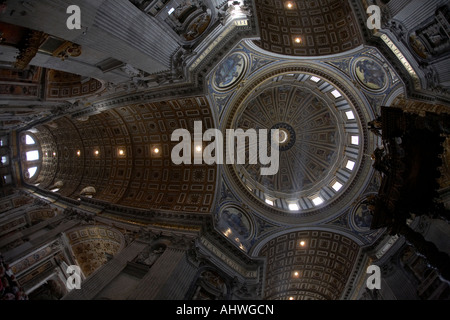 Looking up at the inside of the dome and ceiling of St Peters Cathedral Vatican City Rome Lazio Italy - Stock Photo