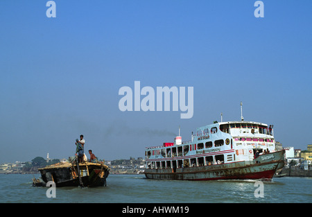 Passenger ferry and small river freighter. Bangladesh - Stock Photo