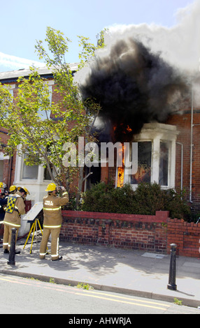 Fire and rescue exercise testing home sprinkler systems - Stock Photo