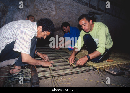 Men making hand made interwoven rush mats in the medina, Fes, Middle Atlas, Morocco, Africa - Stock Photo