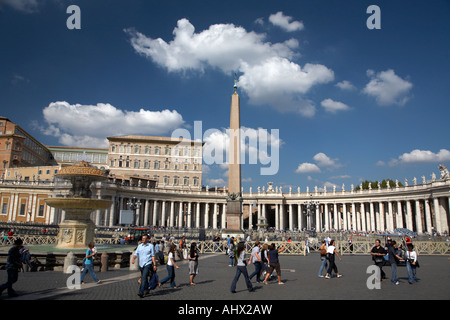tourists walking across St Peters Square Vatican City Rome Lazio Italy - Stock Photo