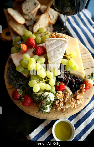 Cheese plate, fresh  fruit platters, party, red wine, white wine, grapes, currants, strawberries, fresh fruit, olive - Stock Photo