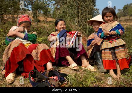 Women from the Flower Hmong Hill Trlbe, Bac Ha, near Sapa, Vietnam - Stock Photo