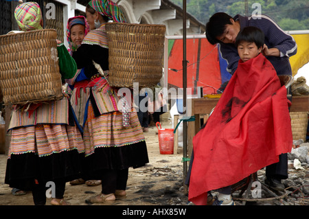 Boy Having a Haicut, Bac Ha Market, near Sapa, Vietnam - Stock Photo
