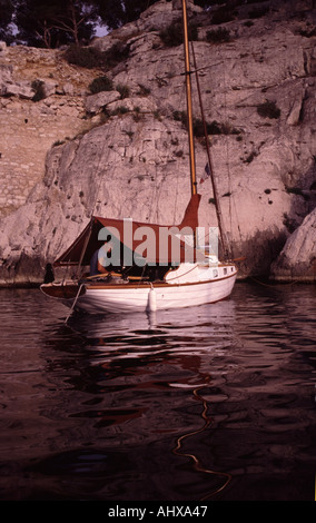 Small yacht anchored in the Calanques in Southern France - Stock Photo