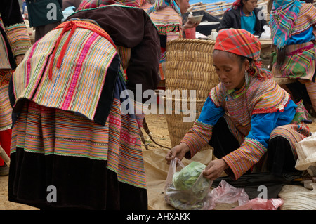 Women from the Flower Hmong Hill Trlbe, Cancau Market, near Sapa, Vietnam - Stock Photo
