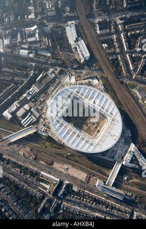High level vertical aerial view of Arsenal Football Club Emirates Stadium building construction site London N5 England - Stock Photo