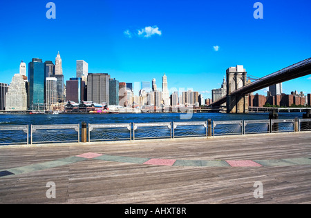 New York City skyline and Brooklyn bridge under blue sky