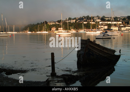 River Tamar wreck and boats reflected in water Plymouth Devon UK  - Stock Photo