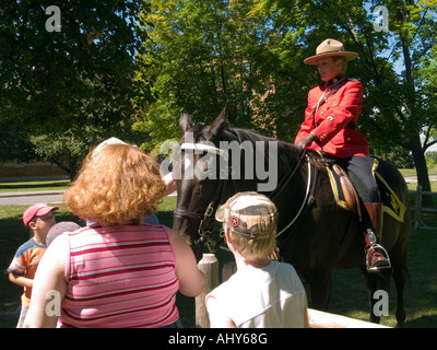 A family talking to a Mountie at the RCMP (Royal Canadian Mounted Police) Musical Ride visitor centre in Ottawa, - Stock Photo