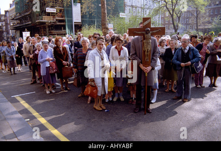 A Roman Catholic Christian procession in Soho Square in London in England in Great Britain in the United Kingdom. - Stock Photo