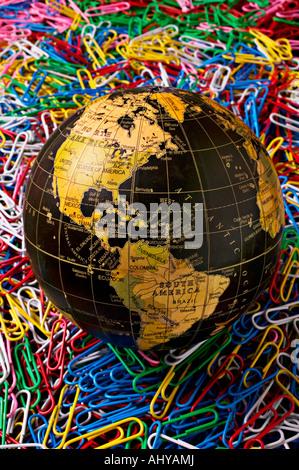 Black globe on paperclips - Stock Photo