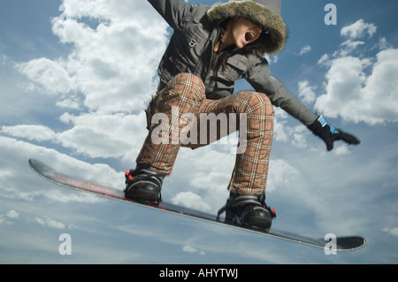 Low angle view of snowboarder jumping - Stock Photo