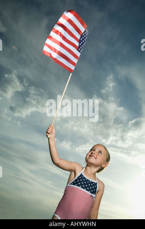Young girl holding American flag - Stock Photo