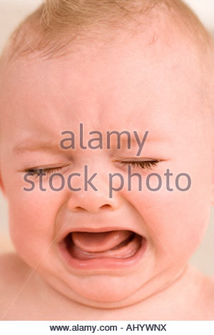 Baby girl 9-12 months crying, close-up - Stock Photo