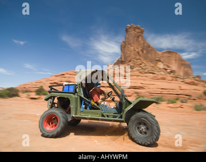 Man driving off-road vehicle in desert - Stock Photo
