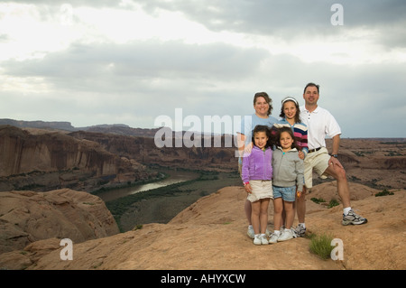 Portrait of family in front of canyon - Stock Photo